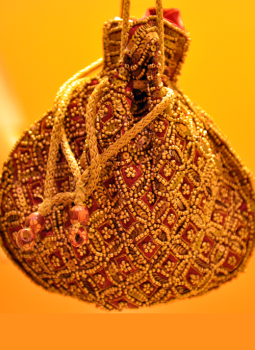 Kutch Embroidered Handbags,Indiacraft,Beadwork potli bags exclusive from Bhopal - Dull Gold on ...
