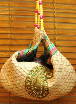 Benarasi potli  bag,Indiacraft,Jute embellished potli bag with bead strings -cream & pin...